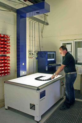 Figure 3: Chris Whitwam inspecting a routed aerospace component on the InspecVision Planar P120.50 measuring machine.
